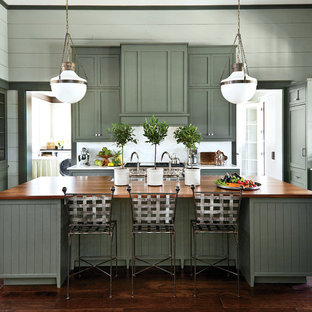 Inspiration for a large country galley eat-in kitchen in Nashville with a double-bowl sink, beaded inset cabinets, green cabinets, marble benchtops, white splashback, stainless steel appliances, dark hardwood floors and with island.