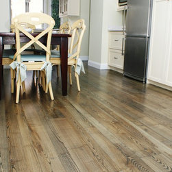 Hull Forest Products - Natural Ash Wood Flooring - Natural grade Ash wood flooring from Hull Forest Products.  This floor features a broad, prominent grain and character marks as found in nature, including occasional knots. Floor shown has had an ebony stain applied.  Lifetime guarantee.