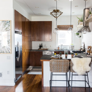 Mid-sized contemporary l-shaped open plan kitchen in San Francisco with a single-bowl sink, flat-panel cabinets, brown cabinets, concrete benchtops, white splashback, subway tile splashback, stainless steel appliances, dark hardwood floors, with island and brown floor.