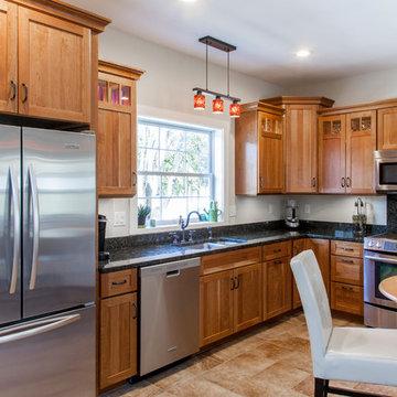 Natural Cherry Shaker kitchen with dark granite countertops