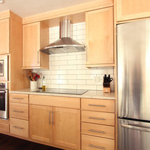Natural Maple Cabinets In Open Kitchen