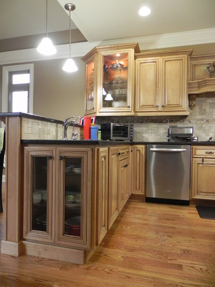 Traditional Kitchen Cabinetry by Whitis Cabinet Design Center