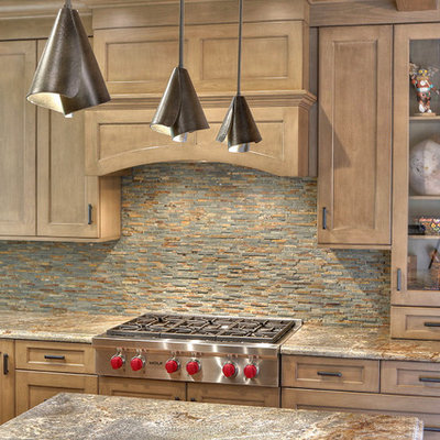 Large eclectic l-shaped ceramic tile eat-in kitchen photo in San Francisco with an undermount sink, shaker cabinets, brown cabinets, granite countertops, multicolored backsplash, stone tile backsplash, stainless steel appliances and an island
