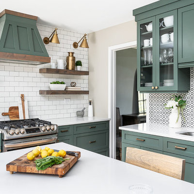 Enclosed kitchen - mid-sized transitional u-shaped light wood floor enclosed kitchen idea in Chicago with an undermount sink, shaker cabinets, green cabinets, quartz countertops, white backsplash, cement tile backsplash, stainless steel appliances, an island and white countertops