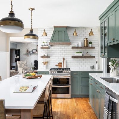 Mid-sized country l-shaped medium tone wood floor and brown floor kitchen photo in Chicago with an undermount sink, shaker cabinets, green cabinets, quartz countertops, white backsplash, cement tile backsplash, stainless steel appliances, an island and white countertops