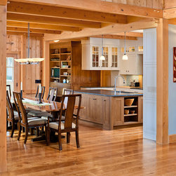 Hull Forest Products - Natural White Oak Kitchen Wood Flooring - Connecticut-grown White Oak wood floors from Hull Forest Products in Pomfret, Connecticut. The homeowners opted for a slight microbevel on the plank edges to help delineate them. Photo by David Lamb Photography. Starting price is $5.68/sf and varies with lengths and widths chosen.