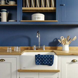This is an example of a beach style kitchen in Wiltshire.