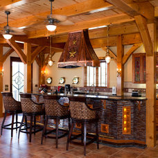 Rustic Kitchen by Texas Timber Frames