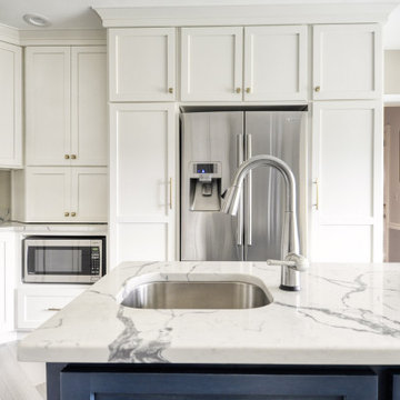 Navy Stained Island, Hood vent and Floating Shelves in White Shaker Kitchen
