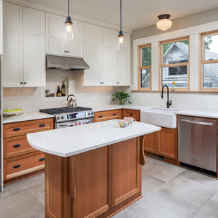 Mid-sized craftsman eat-in kitchen pictures - Mid-sized arts and crafts l-shaped ceramic tile and gray floor eat-in kitchen photo in Portland with a farmhouse sink, medium tone wood cabinets, quartz countertops, white backsplash, stainless steel appliances, an island, recessed-panel cabinets and porcelain backsplash