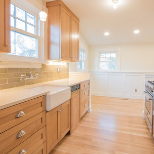 Small transitional enclosed kitchen ideas - Inspiration for a small transitional galley light wood floor and beige floor enclosed kitchen remodel in Portland with a farmhouse sink, shaker cabinets, light wood cabinets, quartz countertops, green backsplash, subway tile backsplash, paneled appliances, no island and white countertops