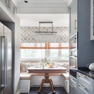 Design ideas for a medium sized classic l-shaped kitchen/diner in New York with a single-bowl sink, grey cabinets, granite worktops, white splashback, ceramic splashback, stainless steel appliances and dark hardwood flooring.