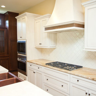 Large traditional eat-in kitchen designs - Inspiration for a large timeless galley dark wood floor eat-in kitchen remodel in Chicago with a single-bowl sink, recessed-panel cabinets, white cabinets, granite countertops, white backsplash, ceramic backsplash, paneled appliances and an island