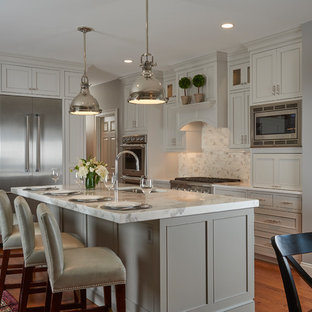Mid-sized transitional eat-in kitchen designs - Example of a mid-sized transitional single-wall medium tone wood floor and brown floor eat-in kitchen design in Boston with an undermount sink, beaded inset cabinets, white cabinets, marble countertops, gray backsplash, marble backsplash, stainless steel appliances, an island and white countertops