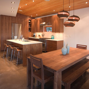 Contemporary eat-in kitchen ideas - Example of a trendy eat-in kitchen design in Seattle with an undermount sink, flat-panel cabinets and medium tone wood cabinets
