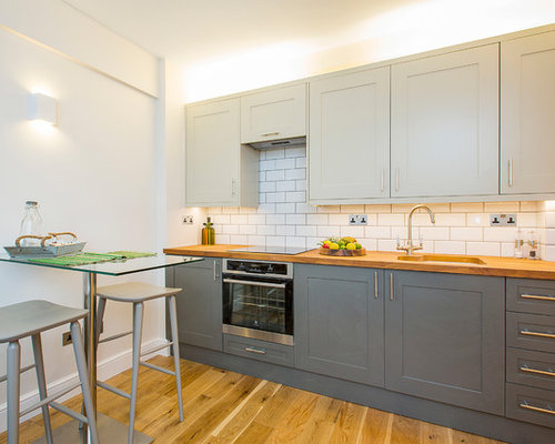 Photo Of A Medium Sized Contemporary Single Wall Kitchen/diner In London  With A