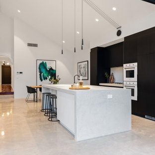 Inspiration for a large contemporary galley eat-in kitchen in Perth with an undermount sink, flat-panel cabinets, black cabinets, grey splashback, panelled appliances, with island, grey floor and grey benchtop.