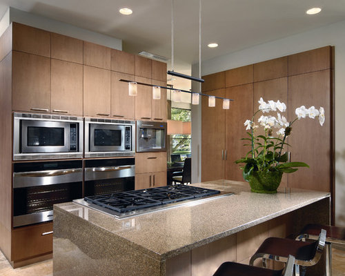 modern kitchen idea in orlando with flat panel cabinets and medium tone wood cabinets. beautiful ideas. Home Design Ideas