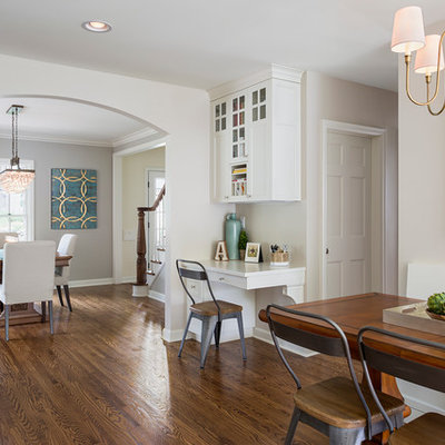 Eat-in kitchen - mid-sized transitional medium tone wood floor eat-in kitchen idea in Minneapolis with shaker cabinets, an island, white cabinets, quartzite countertops, a farmhouse sink, white backsplash and subway tile backsplash