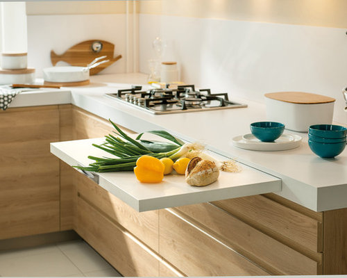 This Is An Example Of A Small Contemporary L Shaped Kitchen In London With  White