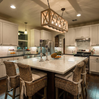 Elegant l-shaped kitchen photo in Austin with a farmhouse sink, marble countertops and white cabinets