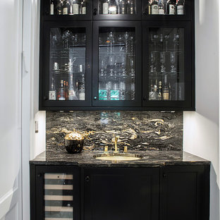 This is an example of a transitional galley kitchen pantry in New York with an undermount sink, recessed-panel cabinets, black cabinets, quartzite benchtops, multi-coloured splashback, stone tile splashback, panelled appliances and marble floors.