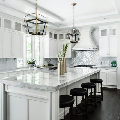 Huge transitional dark wood floor kitchen photo in New York with an undermount sink, shaker cabinets, white cabinets, quartzite countertops, stainless steel appliances, an island and metallic backsplash