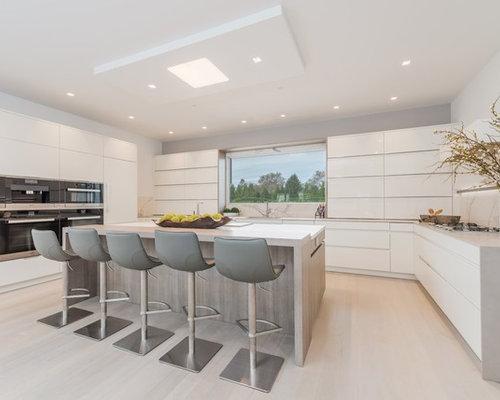 kitchen islands lighting. Trendy U-shaped Light Wood Floor And Beige Kitchen Photo In New York With Islands Lighting