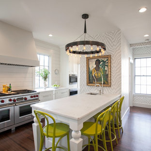 This is an example of a transitional kitchen in Boston with white cabinets and stainless steel appliances.