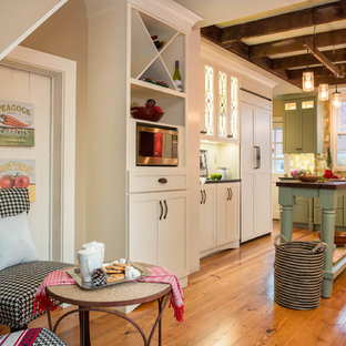 Large farmhouse eat-in kitchen designs - Eat-in kitchen - large cottage u-shaped medium tone wood floor eat-in kitchen idea in Boston with an undermount sink, shaker cabinets, green cabinets, granite countertops, multicolored backsplash, mosaic tile backsplash, paneled appliances and an island
