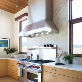 Design ideas for an expansive modern l-shaped open plan kitchen in San Francisco with an undermount sink, flat-panel cabinets, light wood cabinets, marble benchtops, white splashback, marble splashback, stainless steel appliances, marble floors, with island, white floor and white benchtop.