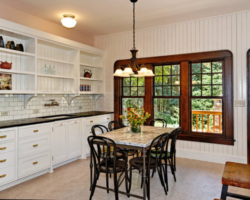 Elegant eat-in kitchen photo in San Francisco with recessed-panel cabinets