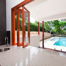 Modern Kitchen by Inspired Constructions Pools and Landscaping