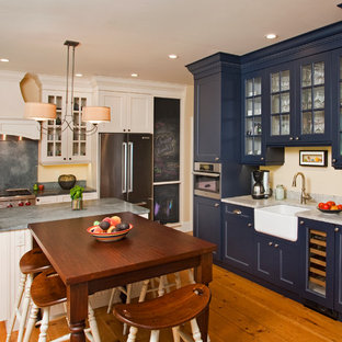 Eat-in kitchen - farmhouse u-shaped eat-in kitchen idea in Philadelphia with a farmhouse sink, glass-front cabinets, blue cabinets, gray backsplash and stainless steel appliances