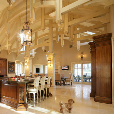 Open concept kitchen - huge traditional travertine floor open concept kitchen idea in New York with dark wood cabinets