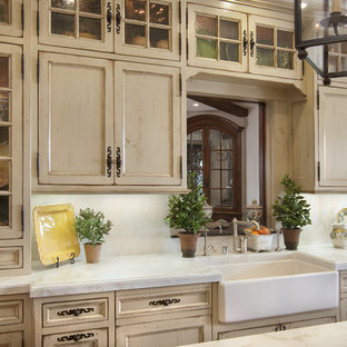 Victorian kitchen in San Diego with recessed-panel cabinets, a farmhouse sink and distressed cabinets.
