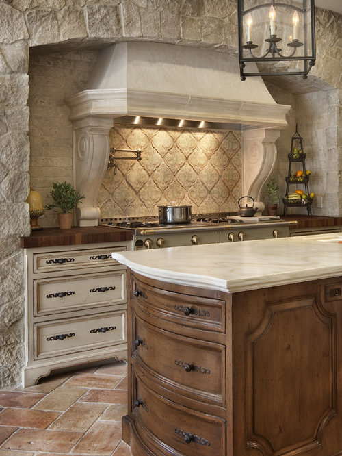 Country Kitchen Cabinets. Tuscan kitchen photo in San Diego with terra cotta backsplash  wood countertops recessed Country Kitchen Cabinets Houzz