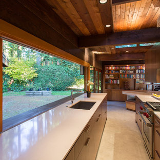 Inspiration for a mid-sized midcentury galley eat-in kitchen in Vancouver with an undermount sink, flat-panel cabinets, medium wood cabinets, stainless steel appliances, quartz benchtops, brick splashback, white benchtop, brown splashback, ceramic floors, no island and beige floor.
