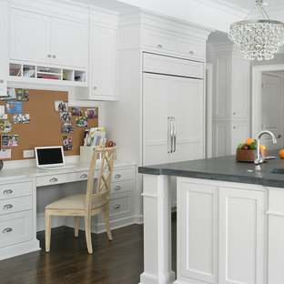 Transitional u-shaped kitchen in New York with an integrated sink, shaker cabinets, white cabinets, panelled appliances, dark hardwood floors and with island.