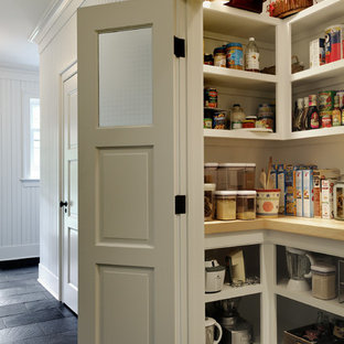 Photo of a traditional kitchen pantry in New York with open cabinets and white cabinets.