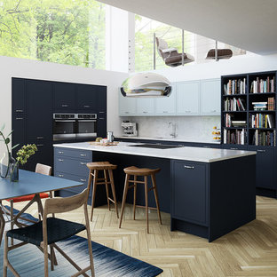 This is an example of a contemporary l-shaped kitchen/diner in Other with a submerged sink, flat-panel cabinets, marble worktops, white splashback, marble splashback, stainless steel appliances, light hardwood flooring, a breakfast bar and beige floors.