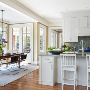Traditional eat-in kitchen designs - Eat-in kitchen - traditional medium tone wood floor and brown floor eat-in kitchen idea in Providence with an undermount sink, shaker cabinets, white cabinets, gray backsplash, an island and green countertops