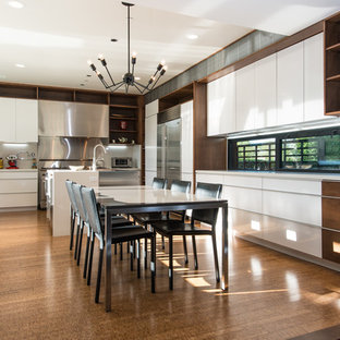 Huge contemporary eat-in kitchen remodeling - Inspiration for a huge contemporary u-shaped bamboo floor eat-in kitchen remodel in Orange County with flat-panel cabinets, white cabinets, stainless steel appliances, an island, metallic backsplash and a farmhouse sink