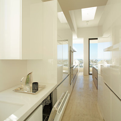 Example of a trendy galley enclosed kitchen design in Los Angeles