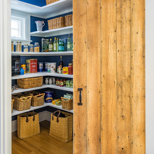 Design ideas for a medium sized farmhouse l-shaped kitchen pantry in Boston with open cabinets, white cabinets, medium hardwood flooring and brown floors.