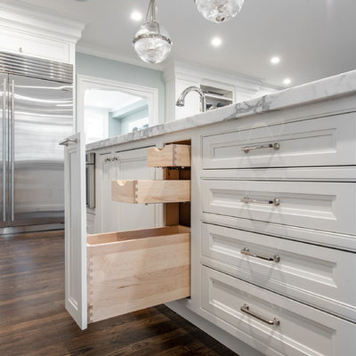 Inspiration for a huge timeless l-shaped dark wood floor and brown floor eat-in kitchen remodel in Boston with an undermount sink, beaded inset cabinets, white cabinets, marble countertops, gray backsplash, marble backsplash, stainless steel appliances, an island and white countertops