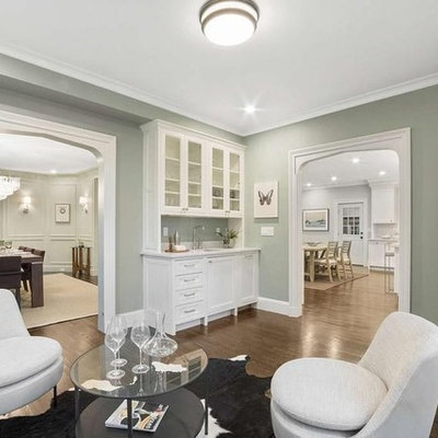 Huge elegant l-shaped dark wood floor and brown floor eat-in kitchen photo in Boston with an undermount sink, beaded inset cabinets, white cabinets, marble countertops, gray backsplash, marble backsplash, stainless steel appliances, an island and white countertops