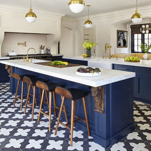 Design ideas for a transitional eat-in kitchen in New York with an undermount sink, beaded inset cabinets, blue cabinets, quartz benchtops, white splashback, ceramic splashback, stainless steel appliances, porcelain floors, multiple islands and multi-coloured floor.