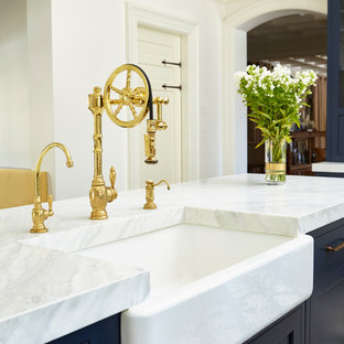 Inspiration for a transitional eat-in kitchen in New York with an undermount sink, beaded inset cabinets, blue cabinets, quartz benchtops, white splashback, ceramic splashback, stainless steel appliances, porcelain floors, multiple islands and multi-coloured floor.