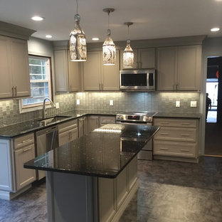 Mid-sized modern eat-in kitchen photos - Example of a mid-sized minimalist l-shaped vinyl floor eat-in kitchen design in New York with a single-bowl sink, shaker cabinets, gray cabinets, granite countertops, gray backsplash, glass sheet backsplash, stainless steel appliances and an island
